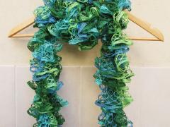 Ruffled Knit Scarf Using Mesh Yarn...Knit By A Ten Year Old!